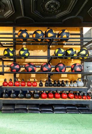 Photo pour Different crossfit items on a rack in a gym. big warehouse - image libre de droit