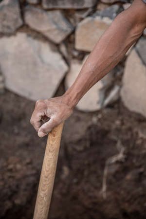 Photo pour Detail of real tired man arm working in the construction. Man resting - image libre de droit