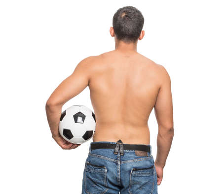 Foto per healthy young man on his back with soccer ball in his hands on white background - Immagine Royalty Free
