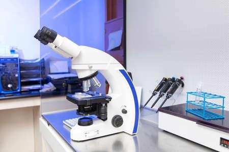 Foto de blue gynecology laboratory microscope with sperm testing - Imagen libre de derechos