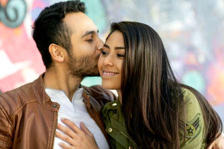 Photo pour Couple in love. Enjoying happy in public park - image libre de droit