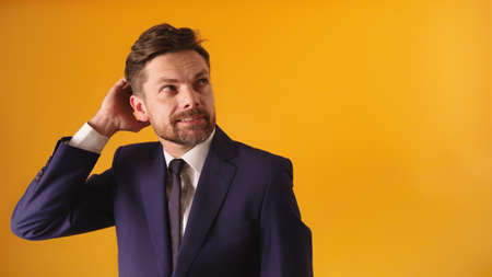 Photo pour Worried businessman scratching his hair head. Unsecure face expression. High quality photo - image libre de droit