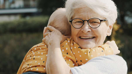 Photo pour close up, happy grandmother embracing her grandson in nature. High quality photo - image libre de droit