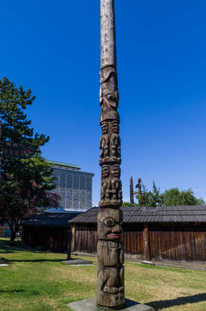 VICTORIA,BC CANADA SEPTEMBER 1,2013: Totem poles in Thunderbird park carved by indigenous Canadians. The park is part of the Royal BC Museums.