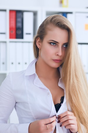Photo pour Sexy secretary undresses in office, flirt and desire. Office provocation. - image libre de droit