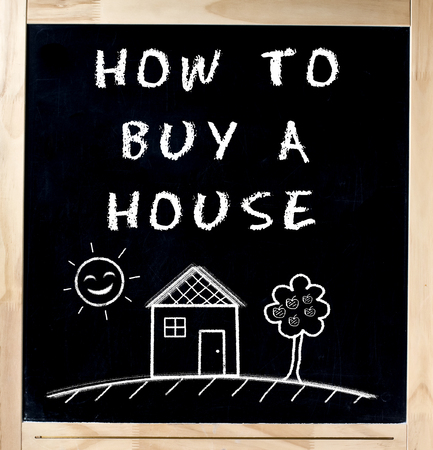 How to buy a house handwritten with basic drawing on blackboard isolated