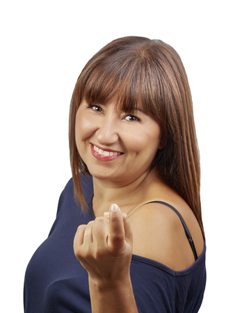 Smiling woman gesturing come here calling you isolated
