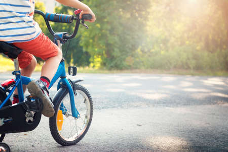 child on a bicycle at asphalt road