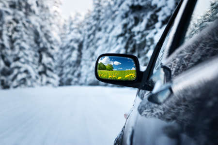 Photo for car on winter road with summer field reflection in mirror - Royalty Free Image