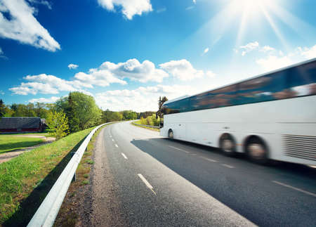 Photo pour Bus on asphalt road in beautiful spring day at countryside - image libre de droit