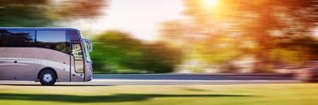 Foto de Bus on asphalt road in beautiful spring day - Imagen libre de derechos