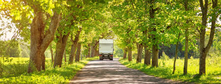 Photo pour Truck moving on alley in summer - image libre de droit