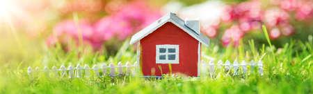 Photo pour red wooden house on the grass in garden - image libre de droit