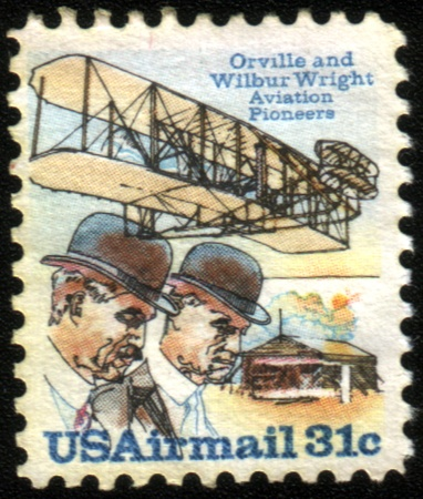 USA - CIRCA 1978: A stamp printed in USA issued for the 75th Anniversary of First Powered Flight showing Wright brothers and Wright Flyer I plane, circa 1978.