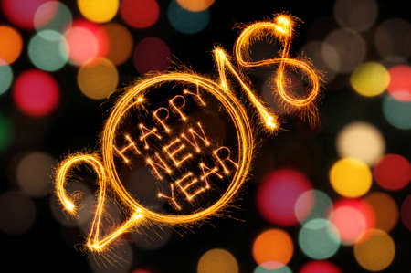 Photo pour Happy New Year 2018 written with Sparkle firework and defocused colorful lights bokeh background - image libre de droit