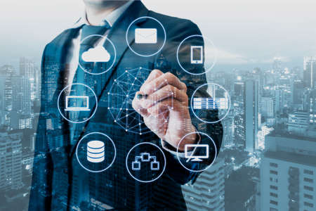Photo pour Double exposure of professional businessman connected devices with world digital technology internet and wireless network on touch screen and city of business background in business and technology concept - image libre de droit
