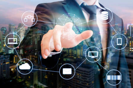 Photo pour Double exposure of professional businessman touch on screen connected devices with world digital technology internet and wireless network and city of business background in business and technology concept - image libre de droit