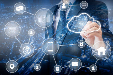 Foto de Double exposure of Professional businessman connecting cloud technology network and devices on hand in internet of things , technology , communication and business concept - Imagen libre de derechos