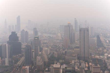Bangkok skyscraper with dust pollution PM 2.5 effects from skywalk rooftop at Mahanakorn tower, Bangkok, Thailand