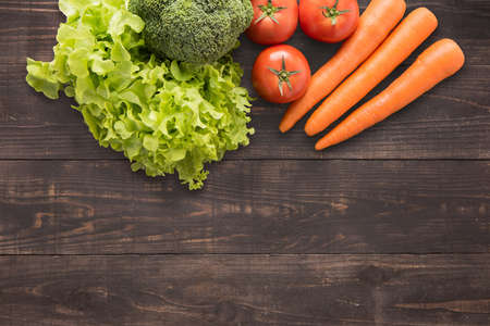 set of fresh vegetables on wood background with a lot of copy space for your text or editing.
