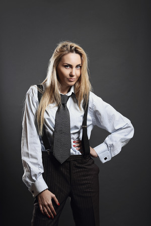 Beautiful woman in business suit . Bold and smart concept