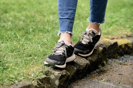 Photo for A lady is jogging on narrow path after wearing new shoes - Royalty Free Image