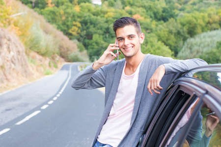 man in the car with the mobile phone