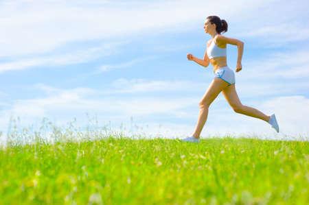 Foto de Mature woman athlete practicing in a spring meadow, from a complete series. - Imagen libre de derechos