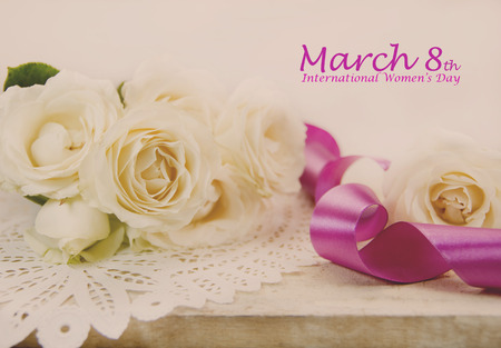 March 8th International Women s Day. Roses and ribbon. Filtered image.の写真素材