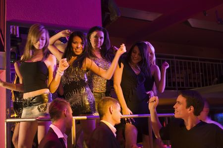 Photo pour group of young people in a disco night club dancing - image libre de droit