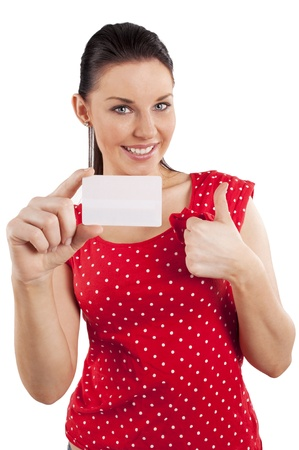 Portrait of happy young woman in red dress with bussiness card against white background