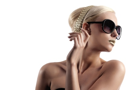 Foto de fashion portrait of young blond woman with hair style gold lips looking in one side with sun glasses  - Imagen libre de derechos