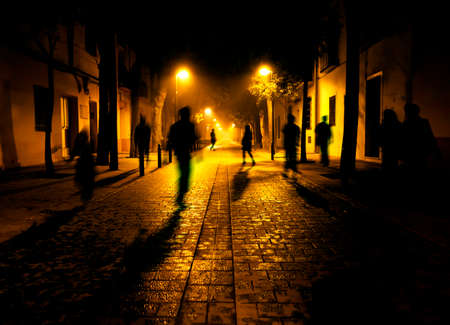 Photo for City at night. Shadows of people walking down the street - Royalty Free Image