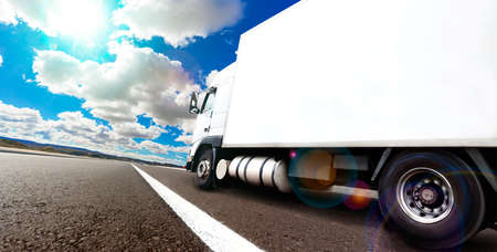 Photo pour Truck and transport. Lorry delivering freight by road or highway - image libre de droit