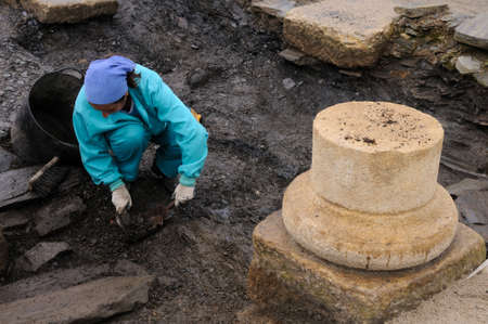 Working in the patio of the  Domus  Archaeological site  Chao Samartin  Asturias SPAIN