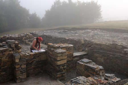 Archaeologist working in the Themal Baths of the   Domus  ( 1 st  AD )   Archaeological site  Chao Samartin  Asturias SPAIN