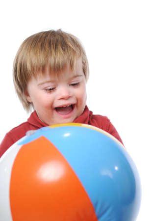 Child with down syndrome p;aying with a ball