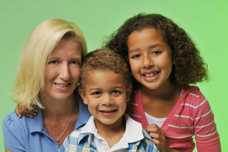 Mother and childrens portrait isolated on a green background