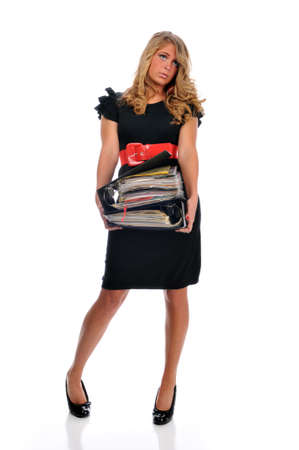 Overworked office employee holding a pile of files against white