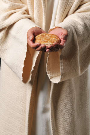 Jesus holding a bread as a symbol of bread of life