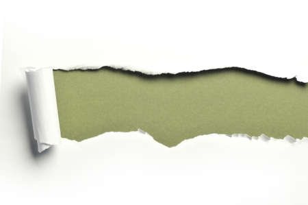 ripped white paper against a green background