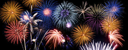 Foto de Fireworks of multiple colors bursting against a black background - Imagen libre de derechos