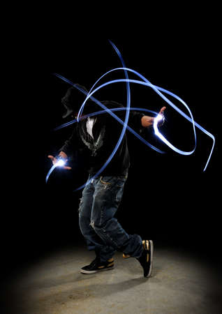Hip Hop Dancer performing showing traces of lighs against a dark background