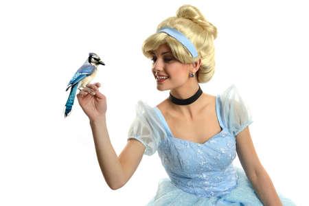 Foto de Cinderella holding a bird isolated on a white background - Imagen libre de derechos