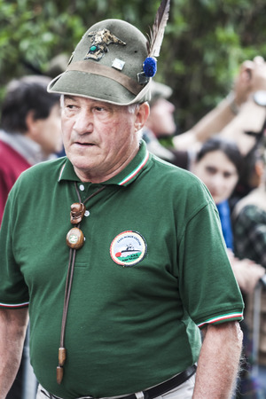 Portrait of an old italian alpine military man walking the street during the alpine parade happened in Pordenone (Italy) - may 2014