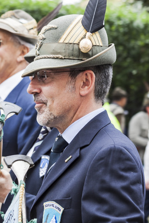 An old italian alpine military man is thinking and remembering past times during the parade of italian alpine military corps happened in Pordenone (Italy) - may 2014