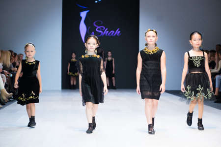 Foto per girl wears children dress collection at the international exhibition of the fashion, Kid's fashion day during Belarus Fashion Week - Immagine Royalty Free