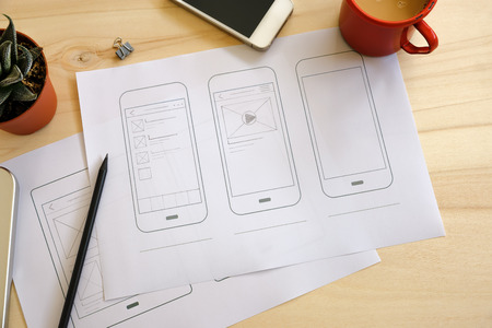 Photo pour Designer desk with UI wireframe sketches. View from above - image libre de droit