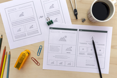 Photo for Designer desk with website wireframe sketches. Flat lay - Royalty Free Image