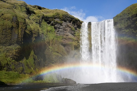 Rainbow at the waterfall Skogafoss in Iceland